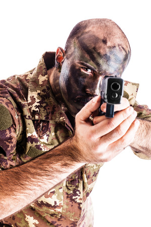 face paint: a soldier wearing camouflege clothing and army face paint isolated over a white background