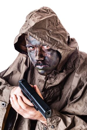 guerrilla warfare: a soldier wearing a poncho or raincoat and army camouflage face paint isolated over a white background