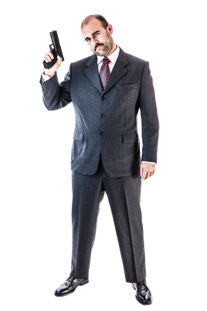 undercover: portrait of a classy businessman or mobster or security guard holding a gun isolated over a white background