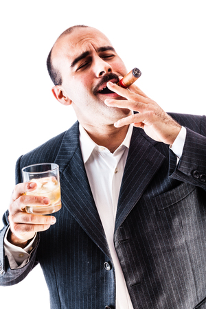 godfather: portrait of a classy businessman toasting with a glass of whiskey and smoking a cigar isolated over a white background
