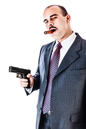 mobster: portrait of an elegant mobster with a cigar and a gun isolated over a white background