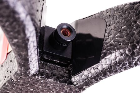 infiltration: close up shot of a drones on board spy micro camera