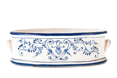 delftware: a decorated white and blue ceramic container isolated over a white background