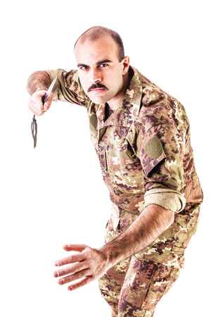 intimidating: a soldier wearing camouflage clothing isolated over a white background
