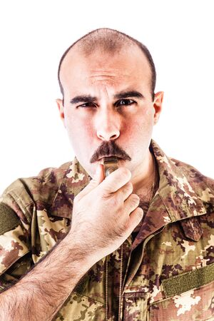 sergeant: a soldier or drill sergeant blowing a whistle isolated over a white background
