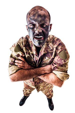 face paint: a soldier wearing camouflage clothing and army face paint isolated over a white background