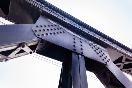 strong toughness: a strong riveted steel beams structure of a railway bridge
