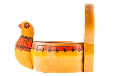 a russian chicken shaped wooden pot isolated over a white background Standard-Bild