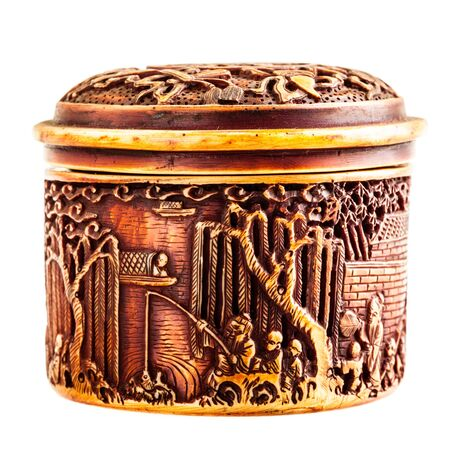 ornated: an ancient chinese ornated container isolated over a white background