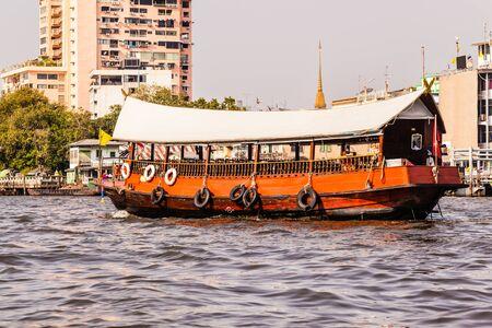 praya: a wooden tourist ferry boat navigating the Chao Praya River in Bangkok