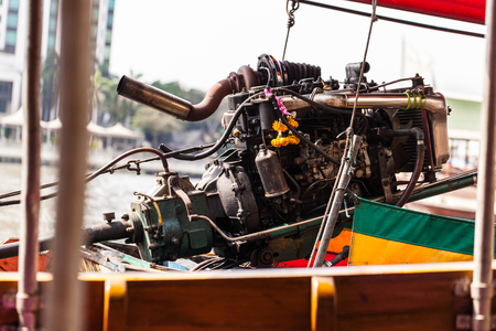 a powerful diesel supercharged engine mounted on a thai long tail speed boat