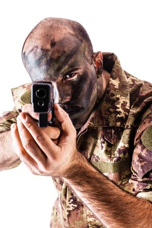army face: a soldier wearing camouflege clothing and army face paint isolated over a white background
