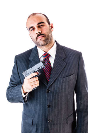 mobster: portrait of a classy businessman or mobster or security guard holding a gun isolated over a white background