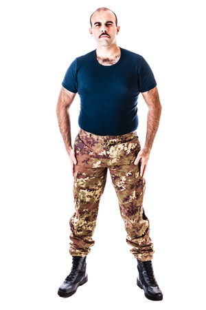 paramilitary: a soldier wearing camouflage clothing isolated over a white background