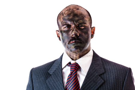 army face: a businessman wearing a suite and army camouflage face paint isolated over a white background