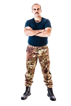 guerilla warfare: a soldier wearing camouflage clothing isolated over a white background