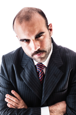 frowns: portrait of a classy businessman wearing a suit isolated over a white background