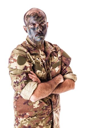 army face: a soldier wearing camouflage clothing and army face paint isolated over a white background