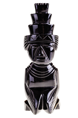 statuette: an aztec obsidian ancient statuette isolated over a white background Stock Photo