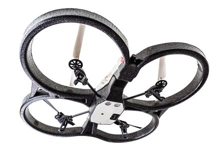 quad: a quad copter spy drone isolated over a white background