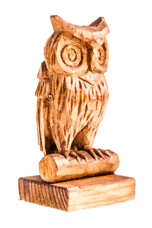 a wooden owl figurine isolated over a white background