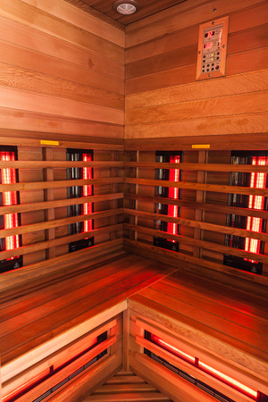 the interior of a small wooden infrarered sauna booth in a spa Banco de Imagens