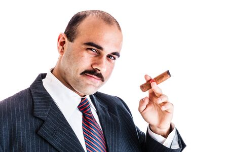 godfather: portrait of a rich businessman smoking a big cigar isolated over a white background