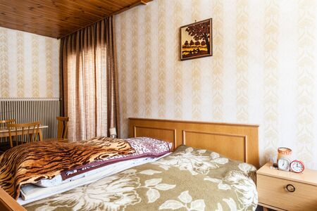 bedspread: a warm bedroom in the morning with the sunlight shining through the window