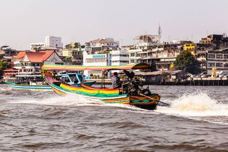 praya: a typical and colorful thai long tail boat speeding on the Chao Praya River in Bangkok City Stock Photo