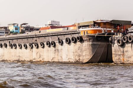 mining ship: a very big barge floating on Chao Praya River in Bangkok, Thailand Stock Photo