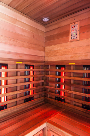 the interior of a small wooden infrarered sauna booth in a spa Stockfoto