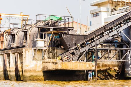 disposal: a garbage disposal plant with a conveyor belt in Thailand