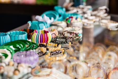 wristbands: a lot of necklaces or wristbands showcased in a tourist shop in thailand