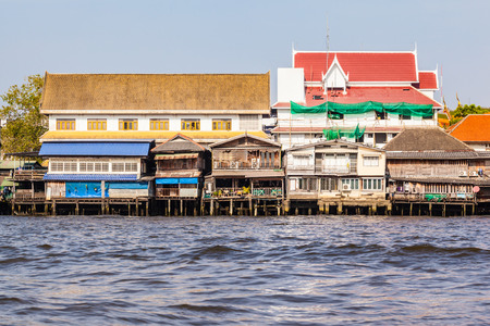 architecture bungalow: Colorful houses on stilts on the riverside of chao Praya River in Bangkok, Thailand
