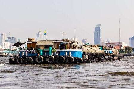 mining ships: a very big barge floating on Chao Praya River in Bangkok, Thailand Stock Photo