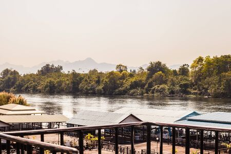 vibrant cottage: hotel on River Kwai in Kanchanaburi province, Thailand. Floating houses near the famous bridge