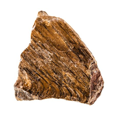 chatoyant: close up shot of a fragment of tigers eye mineral isolated on a white background