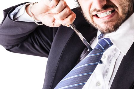 psychopath: a young and handsome businessman holding a cut-throat razor isolated over a white background