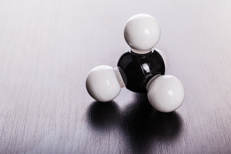 methane: Methane chemical molecular structure model on a wooden surface Stock Photo