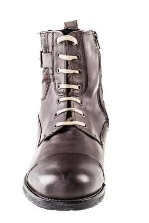 shoestrings: a mans leather fashion boot isolated over a white background Stock Photo