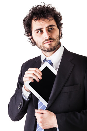 miniaturization: a young and handsome businessman holding a tablet isolated over a white background Stock Photo