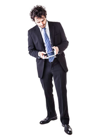 absorbed: a young and handsome businessman holding a tablet isolated over a white background Stock Photo