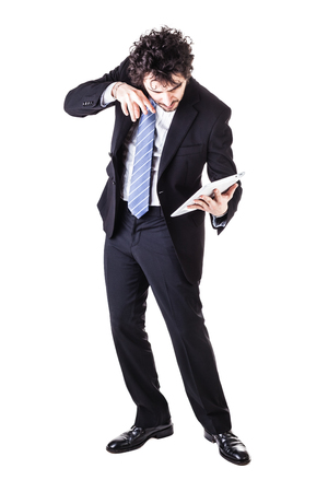 wimp: a young and handsome businessman holding a tablet isolated over a white background Stock Photo