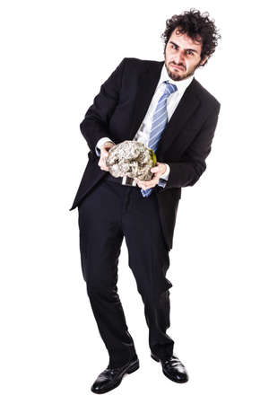 oppressed: a businessman wearing a suit and a tie holding a heavy rock isolated over a white background
