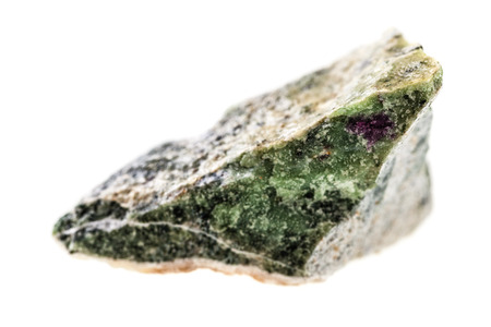gemology: close up shot of a fragment of zoisite mineral isolated on a white background Stock Photo