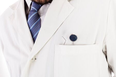 dentalcare: a dentist with dental instruments in the pocket of the white lab coat