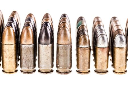 9mm ammo: a lot of old handgun pistol bullets ammo isolated over a white background