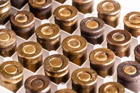 9mm ammo: a lot of 9mm handgun bullets arranged in rows