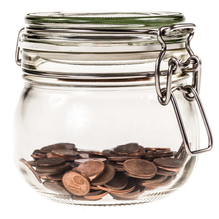 a transparent glass jar filled with euro money isolated over a white background