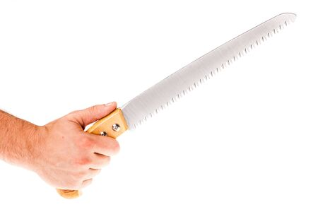 handsaw: a male hand holding a ornated handsaw isolated over a white background
